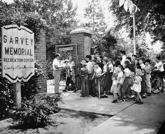 Children at the gates of the Garvey Memorial Recreation Center, 1950