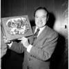 Bob Hope (holds box of Russian cigarettes he passed out among press), 1958.
