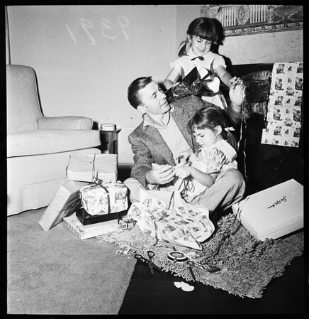 Christmas gift lift for Korea soldiers... wrapping gifts, 1951