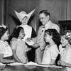 Señor Julio. C. Portela makes a contribution to the Los Angeles Orphanage Building Fund, 1950