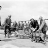 Members of Sierra Madre Search and Rescue Team (Pitchess inspecting units at heliport), 1958.