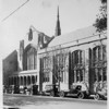 The First Methodist Episcopal Church in Pasadena with cars parked in front, ca. 1905-1930