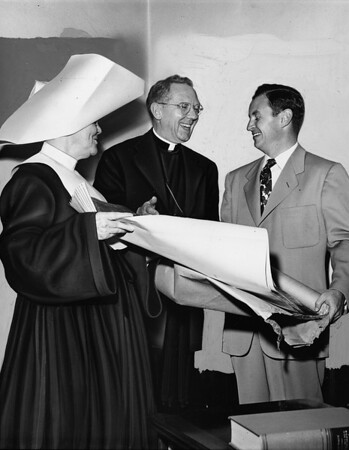 Archbishop McIntyre discusses plans of the Los Angeles Orphanage for a new building, 1950