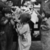 Children at the Los Angeles Orphan's Home Society being treated to Christmas candy, 1929