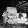 Cleaning New Year's Eve debris at 7th Street and Broadway, 1952