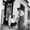 Los Angeles County Tuberculosis and Health Association... Postman delivers seals to home in preview of future deliveries, 1951