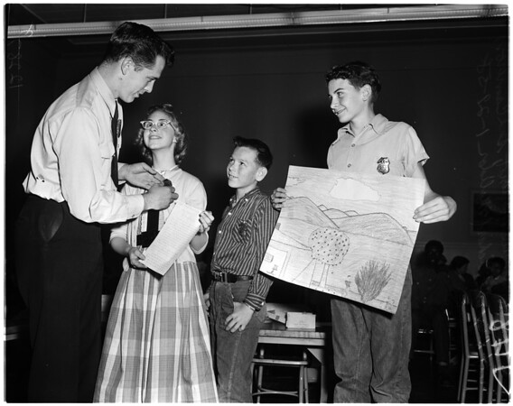 Citations to deaf children for help in fire prevention, 1958