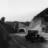Automobile standing before Sepulveda Tunnel portal, 1930