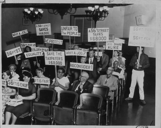 Signs of protest at Pasadena City Directors' meeting, 1958