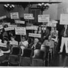 Signs of protest at Pasadena City Directors' meeting, 1958