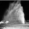Auto hits pole and hydrant ...Main Street and Century Boulevard ...Hydrant shoots water 80 feet in air ... two cars nearby, 1952