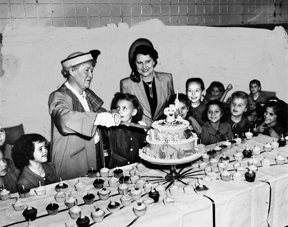 Children of the Los Angeles Orphanage yesterday were guests at an ice cream and cake party
