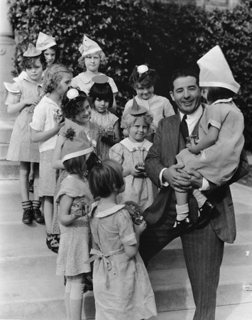 Judge Marchetti with little girls from Los Angeles Orphanage, at New Year celebration, 1935