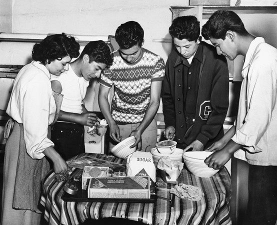 Catholic Youth Organizations teenagers making dough-nuts, Brownson House, 1948