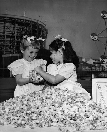 Los Angeles Orphanage orphans play in a pile of taffy at the Nu-Pike, 1950
