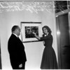 Miss USA looking over picture of Long Beach float for 1947, 1957