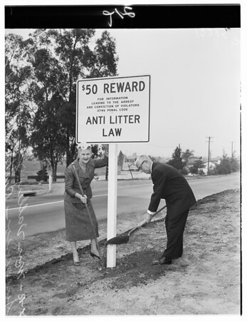 Putting up sign for anti-litter law, 1958