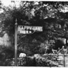 Close-up of street sign for West Happy Lane, 8000 West, Hollywood Hills, 1959