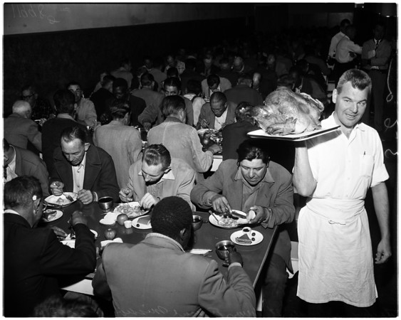 Homeless get mission feast (Thanksgiving), 1956