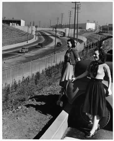 Automobile Club of Southern California photograph two smiling women in parking lot looking down at Olympic Boulevard in distance