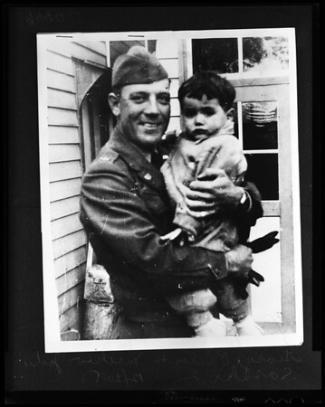 Warrant Officer Casler trying to adopt little Japanese boy, 1951