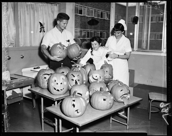 Jack-o-lanterns presented to pediatrics ward at University of California Los Angeles Medical Center, 1957