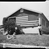 Large American flag at Fata home (4377 Lowell Street), 1957