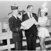 Port Manager presented with 75-pound slice of cheese from Wisconsin, 1958