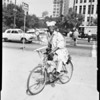 Bicyclist arrives at City Hall, 1952