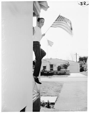 Little boy starts neighborhood displaying flag, 1961