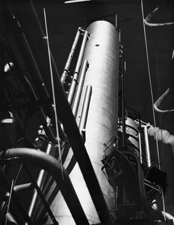 An artistic and unusual view of a distillation column at a refinery