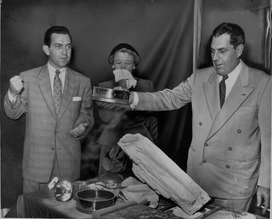 Mrs. Elain Stewart resorts to a handkerchief as engineer Leo Carlstrom shows fine dust that would come from a proposed mine in Palos Verdes