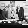 Rotary club No. 5 salvation army committee discusses project at SA center, 1957