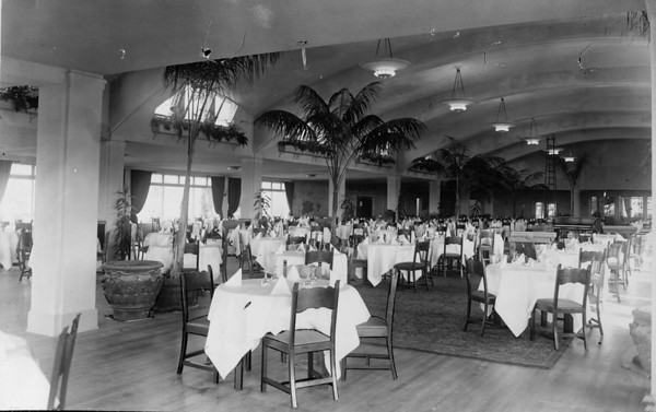 Large elegant dining room under a vaulted ceiling in a hotel