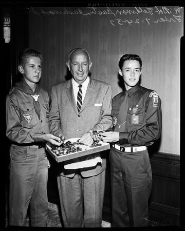 Boy Scouts grab at new kerchief slides, 1957