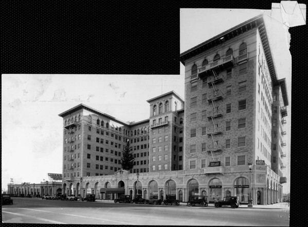 Eight-story hotel or apartment building with arched facade around 1st floor