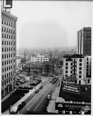 Olympic Boulevard west from Flower Street Seaboard finance Company in foreground (999 South Flower Street)