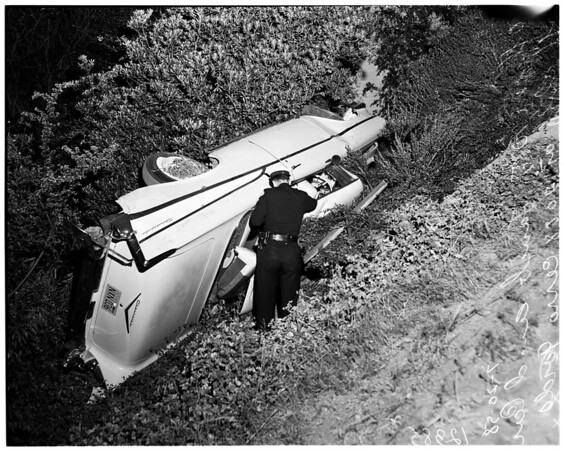 Car over cliff at 2088 Cerro Gordo Street, 1958