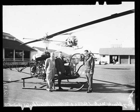 Congressman visit fire area (flight over mountains in helicopter), 1957