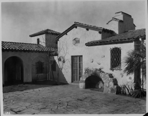 An outside fireplace on the patio of A.E. Cameron's Spanish-style residence