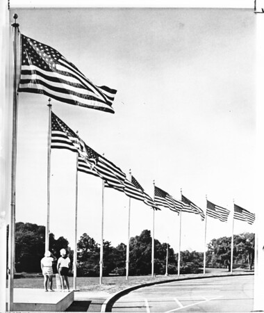 Youngsters at row of flags near Washington Monument, 1959