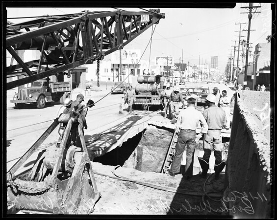 Broken water main in 1200 block on south Vermont, 1960