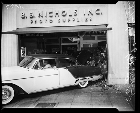 Car in window of camera shop, 1959