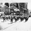 "Photo of the 800 block of South Broadway during the World War II era, with a parade in progress for the ""U.S. Army Troops"""