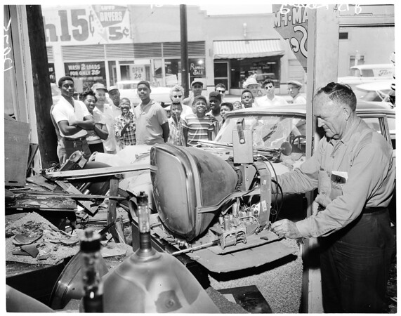 Auto crashes into TV store, 1961