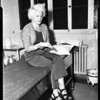 Woman shot in hand, 1957.