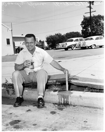 Heat makes sidewalk buckle (508 East Florence Avenue), 1957