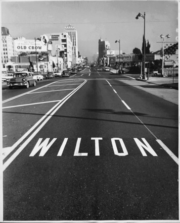 The intersection of Wilshire Boulevard and Wilton Drive, facing east towards downtown