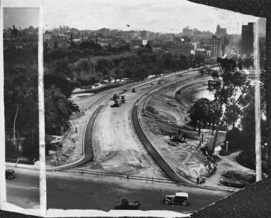 View of Wilshire Boulevard facing east, as the extention through MacArthur park is being constructed and paved