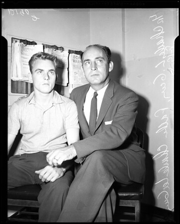 Murder suspect with father, 1957